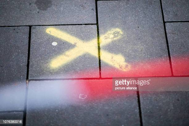 01 January 2019 North RhineWestphalia Bottrop A police barrier tape hangs on Berliner Platz A yellow police marking cross is painted on the floor On...