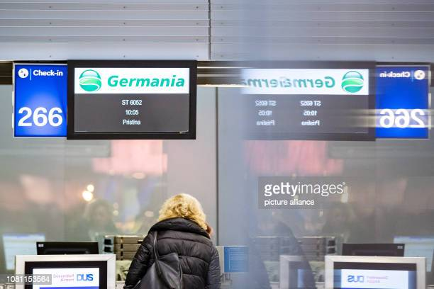 11 January 2019 North RhineWestphalia Düsseldorf A counter of the airline Germania is reflected in a window at Düsseldorf Airport Photo Marcel...