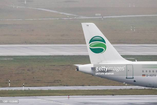 11 January 2019 North RhineWestphalia Düsseldorf An aircraft of the airline Germania rolls over the apron of the Düsseldorf airport when it rains...