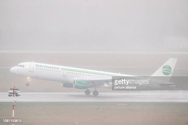 11 January 2019 North RhineWestphalia Düsseldorf An aircraft of the airline Germania takes off at Düsseldorf Airport in Regen Photo Marcel Kusch/dpa