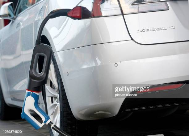 08 January 2019 North RhineWestphalia Duisburg A Tesla Model S is charged via an adapter with a CCS connector The charging station can charge the...