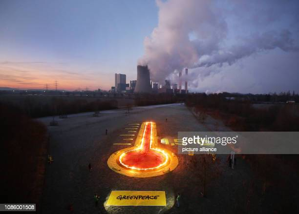 22 January 2019 North RhineWestphalia Rommerskirchen Greenpeace activists have ignited flammable liquids in containers symbolising a thermometer in...