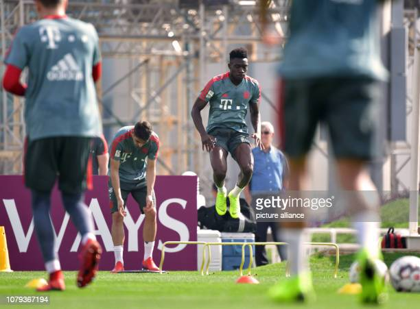 Soccer Bundesliga Alphonso Davies of FC Bayern Munich the Bundesliga soccer team jumps over an obstacle during a training session in the morning FC...