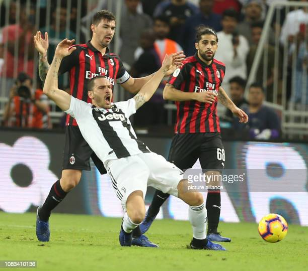 Milan's Alessio Romagnoli and Juventus' Leonardo Bonucci battle for the ball during the Italian Super Cup final soccer match between Juventus and AC...
