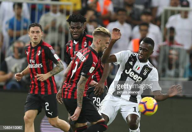 Milan's Cristian Zapata and Franck Kessie battle for the ball with Juventus' Blaise Matuidi during the Italian Super Cup final soccer match between...