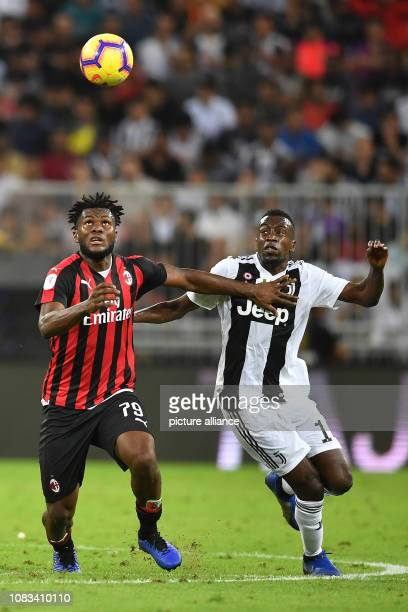 Milan's Franck Kessie battles for the ball with Juventus' Blaise Matuidi during the Italian Super Cup final soccer match between Juventus and AC...