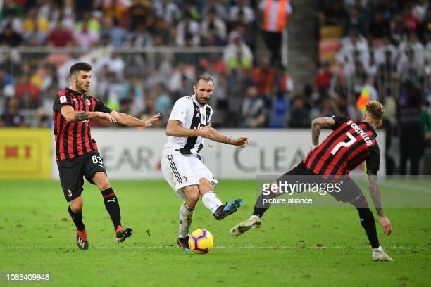 Milan's Samu Castillejo and Patrick Cutrone battle for the ball with Juventus' Giorgio Chiellini during the Italian Super Cup final soccer match...