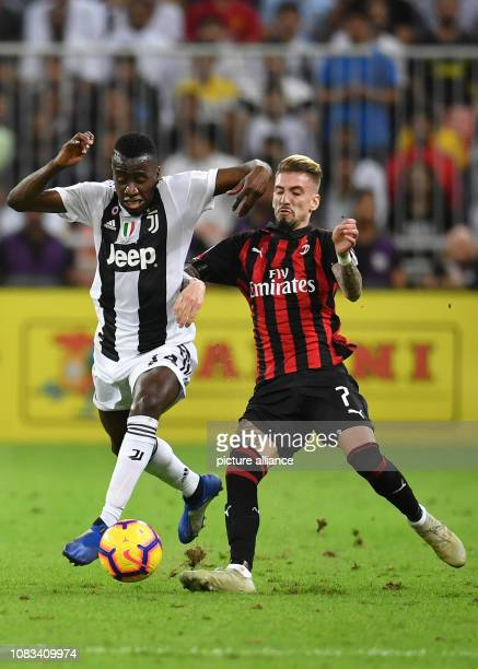 Milan's Samu Castillejo battles for the ball with Juventus' Blaise Matuidi during the Italian Super Cup final soccer match between Juventus and AC...