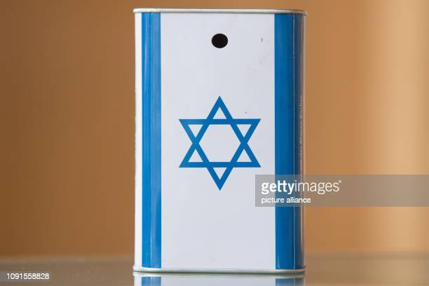 A metal donation box with the flag of Israel stands on a table in the community centre of the Jewish community in Dresden Photo Sebastian...