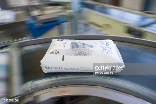 A sack of salt for chemical use is transported by a conveyor belt in the packaging of the European Salt Company The company produces salt in the...