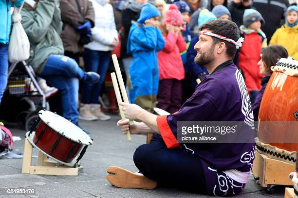19 January 2019 SaxonyAnhalt Magdeburg Members of the Japanese drum group Akaishi Daiko play in front of the stage at an event of the initiative...