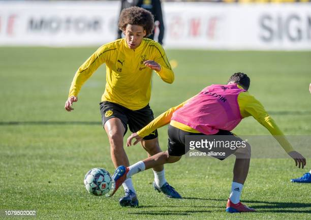 Soccer Bundesliga training camp Borussia Dortmund Axel Witsel and Achraf Hakimi fight for the ball Photo David Inderlied/dpa
