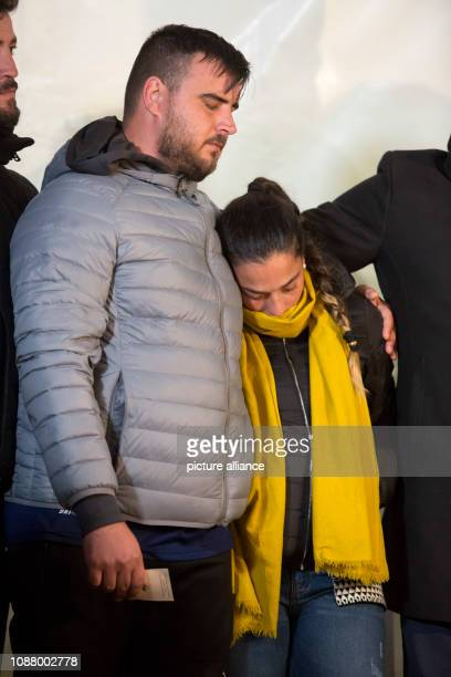 Jose Rosello and Vicky Garcia parents of the twoyearold Julen close their eyes and hug each other at a meeting point with the media Julen is said to...