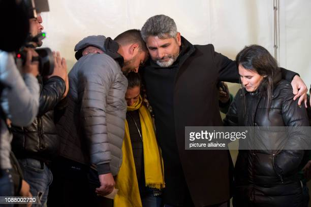Juan Jose Cortes father of a girl murdered in 2008 embraces Jose Rosello and Vicky Garcia parents of twoyearold Julen who is said to have fallen into...