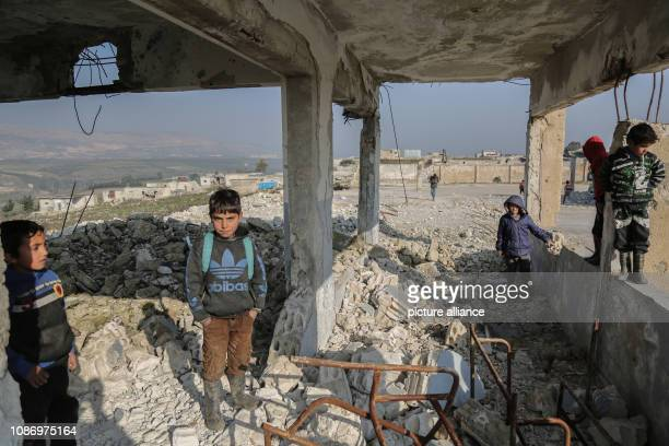 Syrian children play among the rubble of the damaged Al Kefir school at Jisr alShughur in the rebelheld Idlib Province More than 200 students are...