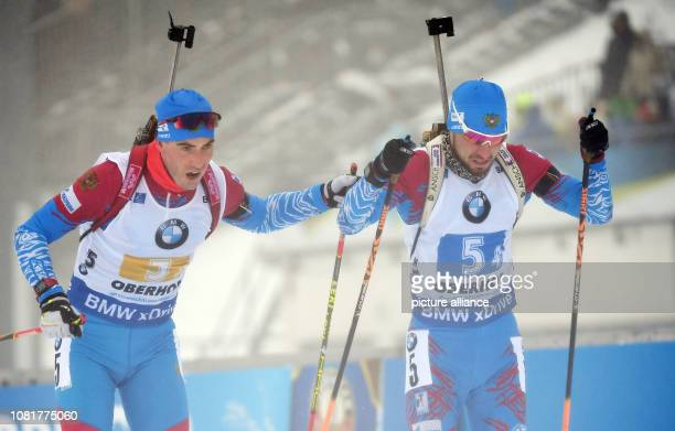 Biathlon World Cup relay 4 x 75 km men Dmitry Malyshko hands over to Alexander Loginov both from Russia Russia wins after the women also the men's...