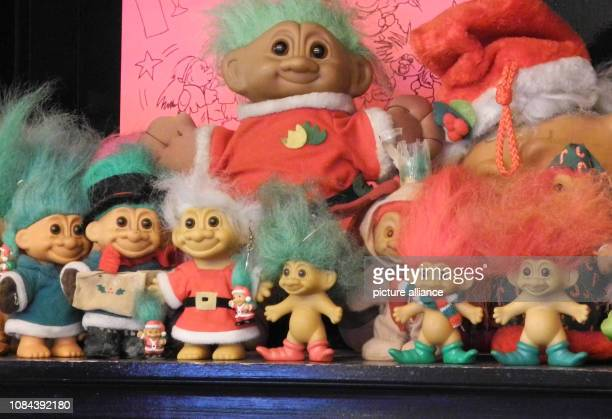 In the lobby of a New York hotel there are colorful dolls The socalled magic trolls with button eyes and brightly coloured shag hair belonged until...