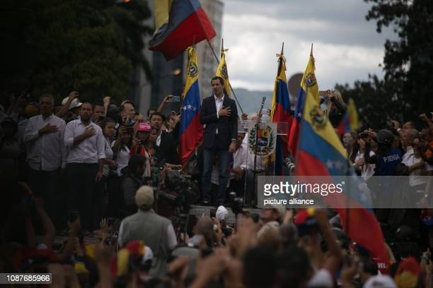 Juan Guaido president of the disempowered parliament in Venezuela declares himself head of state at a rally in front of supporters Guaido called on...