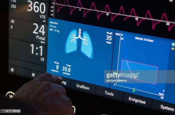 A doctor operates a ventilator in an intensive care unit Photo Marijan Murat/dpa