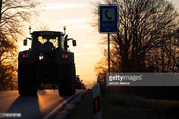 "January 2020, Baden-Wuerttemberg, Schwieberdingen: A tractor drives to a protest procession of the farmers' association ""Land schafft Verbindung""..."
