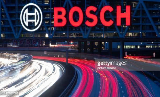 January 2020, Baden-Wuerttemberg, Stuttgart: Cars drive under the logo of Robert Bosch GmbH on the motorway. Photo: Sebastian Gollnow/dpa