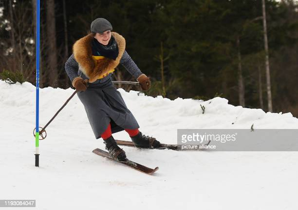 """January 2020, Bavaria, Krün: A participant of the """"Nostalski"""" race rides wooden skis without edges. Historical skis, boots and bindings are..."""