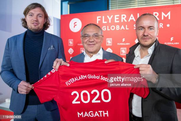 Felix Magath former international player and football coach stands with a jersey in his hands during a press conference on his new function as CEO of...