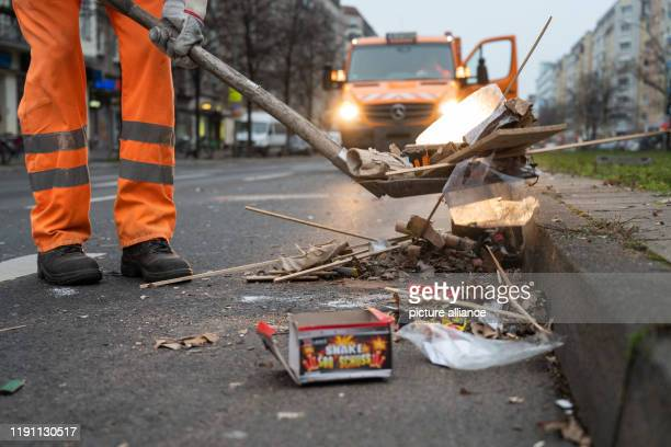 January 2020, Berlin: An employee of Berliner Stadtreinigung BSR clears burnt fireworks from a street. After the New Year's Eve party, BSR starts the...
