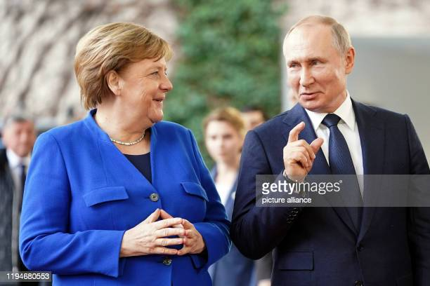 January 2020, Berlin: Chancellor Angela Merkel receives Vladimir Putin, President of Russia, in front of the Federal Chancellery for the Libya...