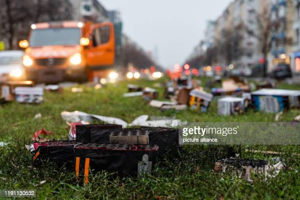 January 2020, Berlin: On a central reservation lies burnt fireworks. After the New Year's Eve party, the Berlin city cleaning service BSR will begin...