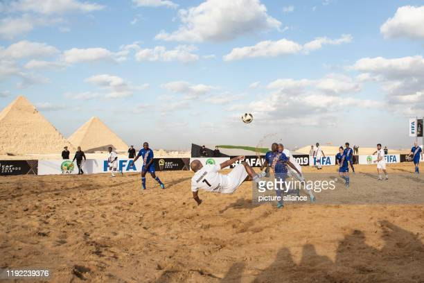 A view of the exhibition match between the CAF and FIFA Legends at the Giza Pyramids complex ahead of the CAF awards 2019 The CAF awards 2019 Gala is...