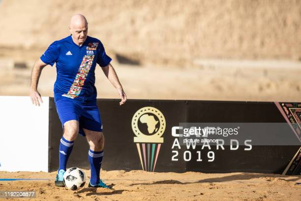 January 2020, Egypt, Giza: FIFAPresident Gianni Infantino in action during the CAF and FIFA Legends soccer match at the Giza Pyramids complex, ahead...