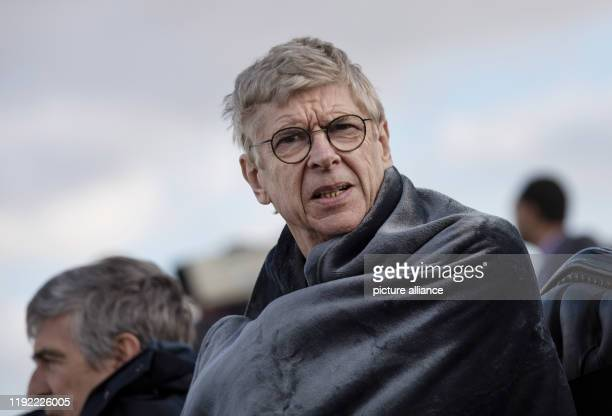 Arsene Wenger former FC Arsenal coach follows a friendly match played before the 2019 CAF Awards The award in honour of the best African football...