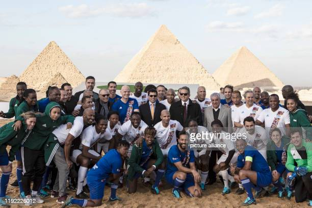 January 2020, Egypt, Gizeh: The members of the CAF and FIFA teams that played a friendly match before the 2019 CAF Awards are standing for a photo....
