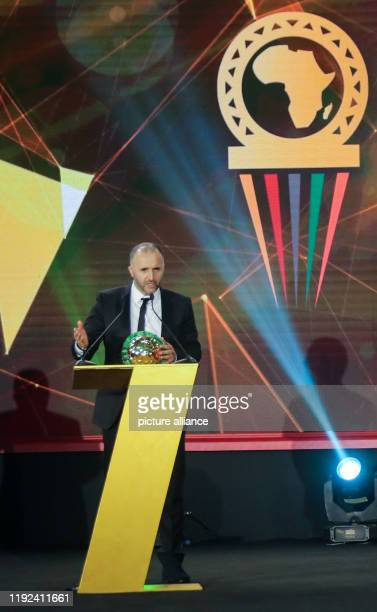 Algerian national team coach Djamel Belmadi speaks after receiving the Men's Coach of the Year award during the 2019 CAF Awards ceremony at Albatros...