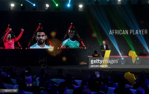 CAF President Ahmad Ahmad presents the the Player of the Year award during the 2019 CAF Awards ceremony at Albatros Citadel Photo Ibrahim Youssef/dpa