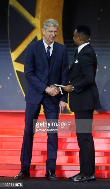 Former Cameroonian footballer Samuel Eto'o and French football manager Arsene Wenger on stage during the 2019 CAF Awards ceremony at Albatros Citadel...