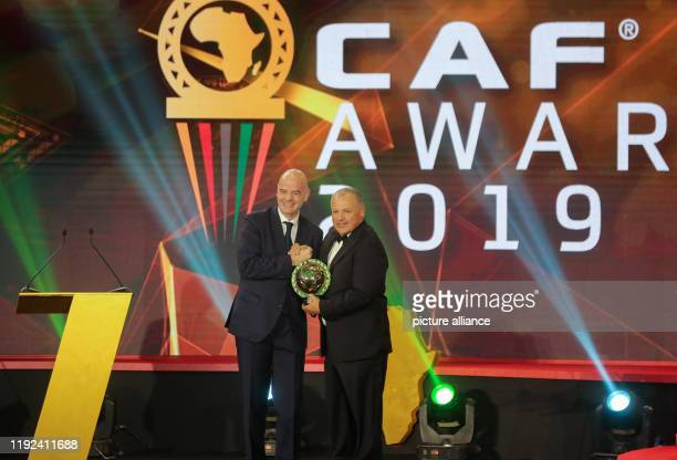 President of the Egyptian Football Association Hany Abo Rida receives the Federation of the Year award from FIFA president Gianni Infantino during...
