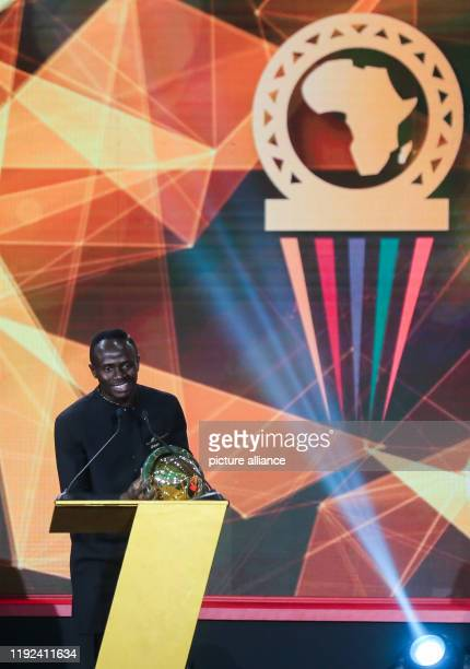 Senegalese footballer Sadio Mane speaks after receiving the Player of the Year award during the 2019 CAF Awards ceremony at Albatros Citadel Photo...