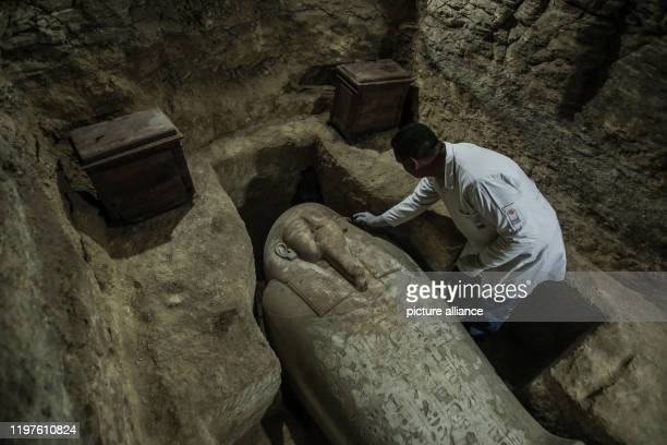 January 2020, Egypt, Minya: An archaeologist works inside a communal tomb, one of three newly discovered tombs of the high priests of ancient...
