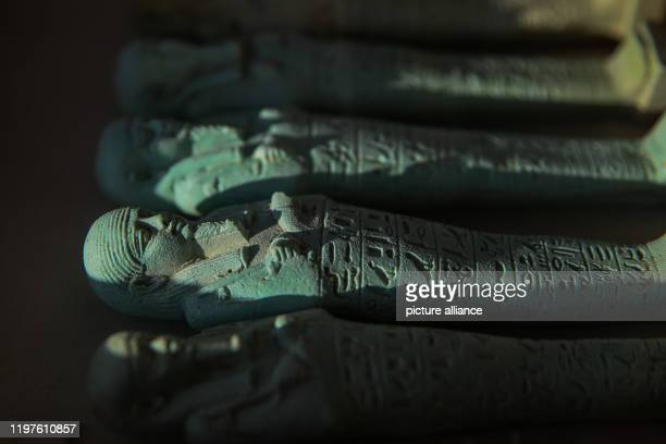 January 2020, Egypt, Minya: Artifacts lie inside a display box as part of the findings unearthged from three newly discovered communal tombs of the...