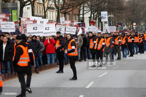 """January 2020, Hamburg: People demonstrate with posters """"KZ #MadeInChina"""" against the oppression of the Muslim minority of the Uigurs in China. The..."""
