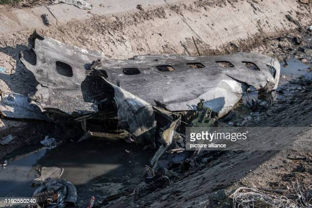 A piece of airplane fuselage at the scene where a Ukrainian airplane carrying 176 people crashed on Wednesday shortly after takeoff from Tehran...