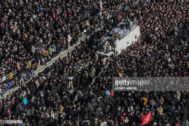 January 2020, Iran, Tehran: Coffins of commander of the elite Quds Force of the Iranian Revolutionary Guard Qassem Soleimani and Abu Mahdi...