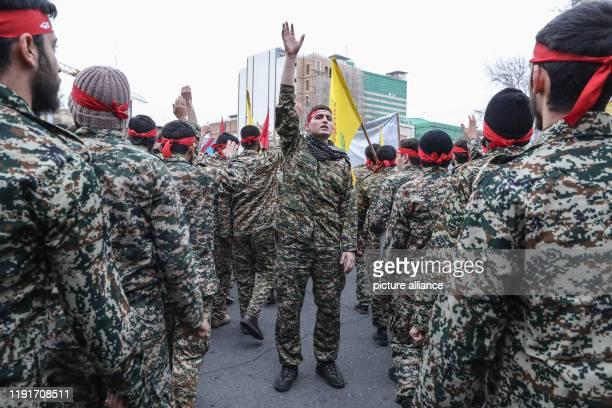 January 2020, Iran, Tehran: Members of the Iranian Basij paramilitary volunteer militia take part in a mourning rally at Felestin Square in honour of...