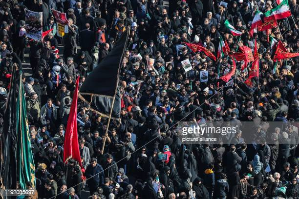 January 2020, Iran, Tehran: Mourners attend a funeral ceremony for commander of the elite Quds Force of the Iranian Revolutionary Guard Qassem...