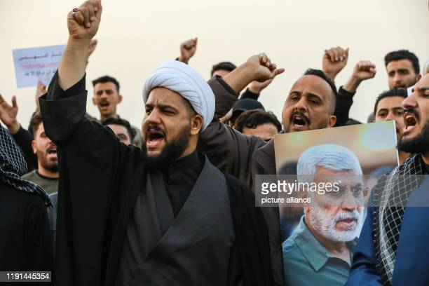 January 2020, Iraq, Baghdad: Supporters of the predominantly Shia Muslim Popular Mobilization Forces shout slogans during an anti-US protest after...