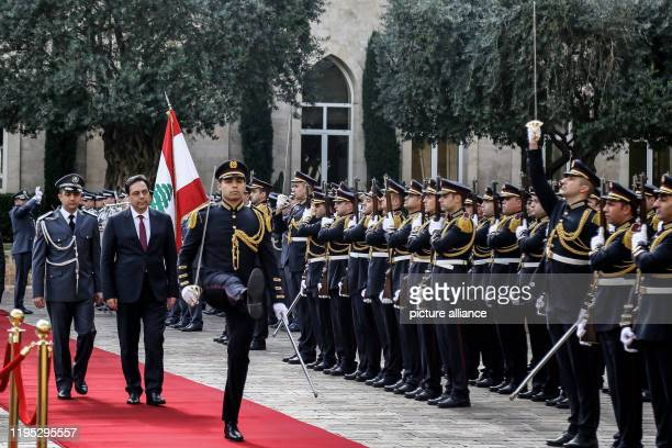 January 2020, Lebanon, Beirut: Lebanese new Prime Minister Hassan Diab reviews an honour guard as he arrives at his office in Beirut's Grand Serail....