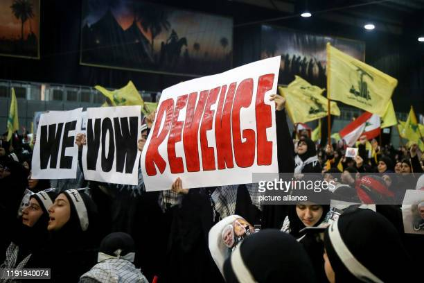 January 2020, Lebanon, Beirut: Supporters of Lebanon's Iran-allied Hezbollah movement, hold banners vowing for revenge, as they attend a mass rally...