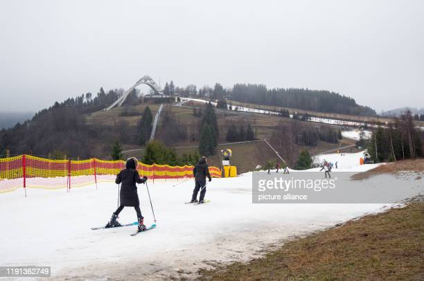 January 2020, North Rhine-Westphalia, Winterberg: Winter sports enthusiasts are on their way on slopes made of artificial snow. Photo: Caroline...